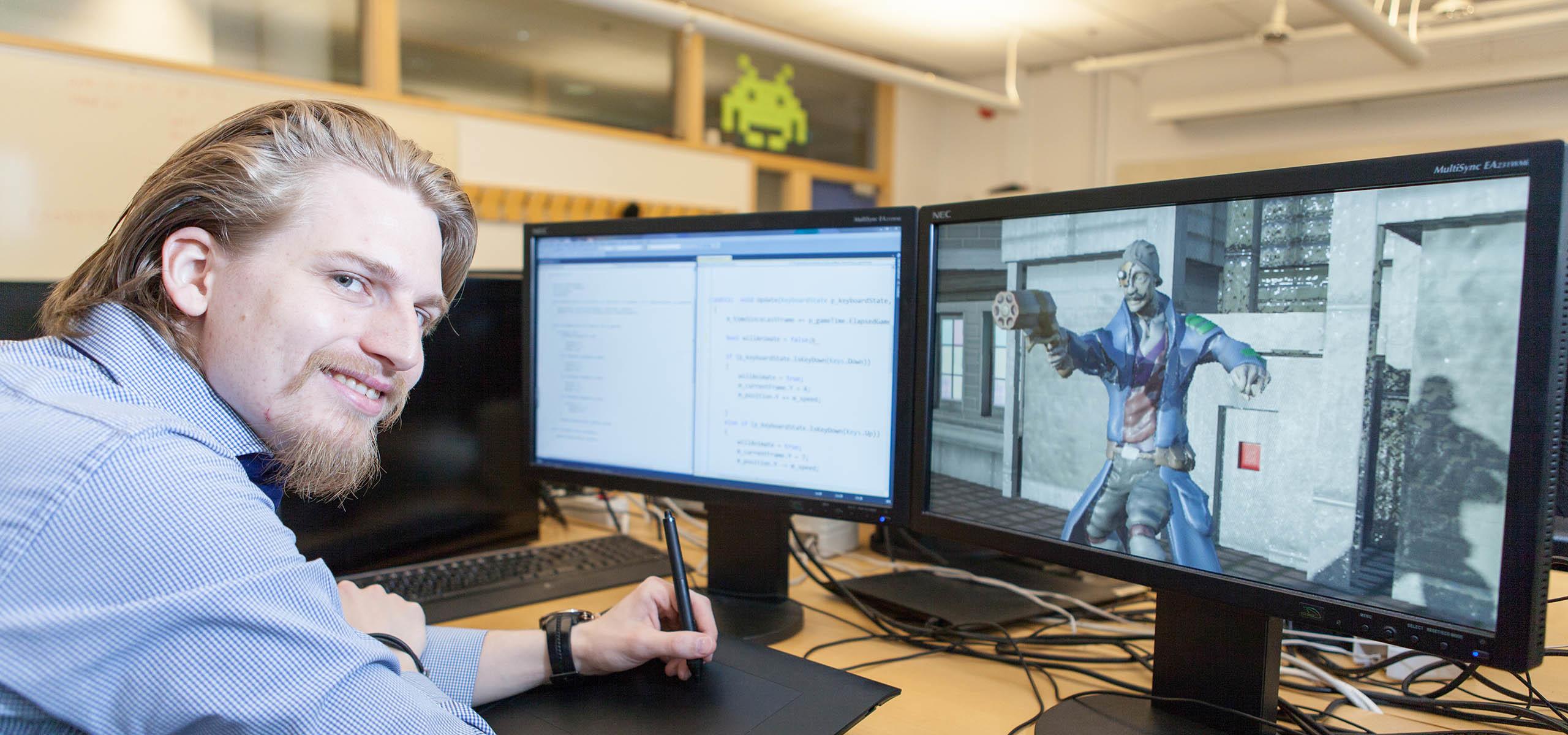 student framför datorskärmar