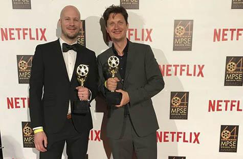 Fredrik Dalenjäll till höger i svart kostym