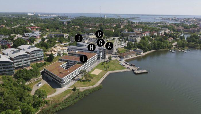 Flygfoto med kartsymboler över Campus Gräsvik