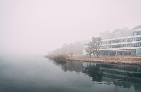 A foggy view of Campus Gräsvik from the water
